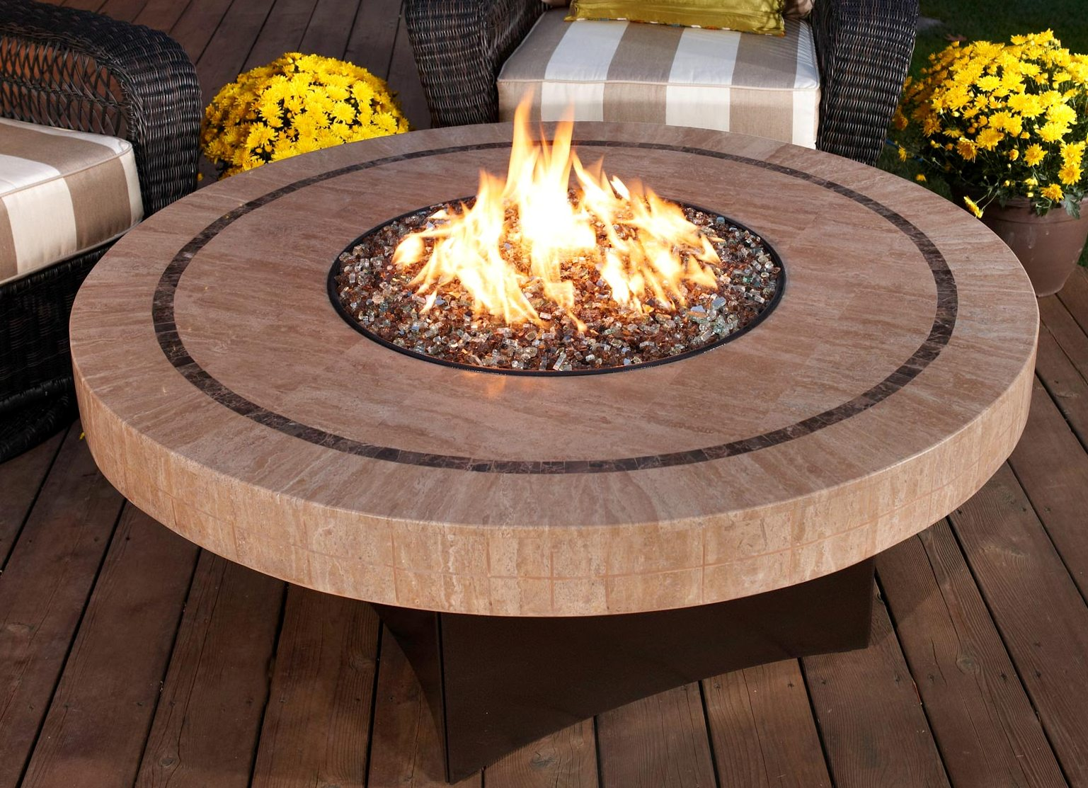 This stone Oriflamme fire table features a unique sandstone mosaic tabletop design. Order this beautiful Sahara fire pit table online from AllBackyardFun!