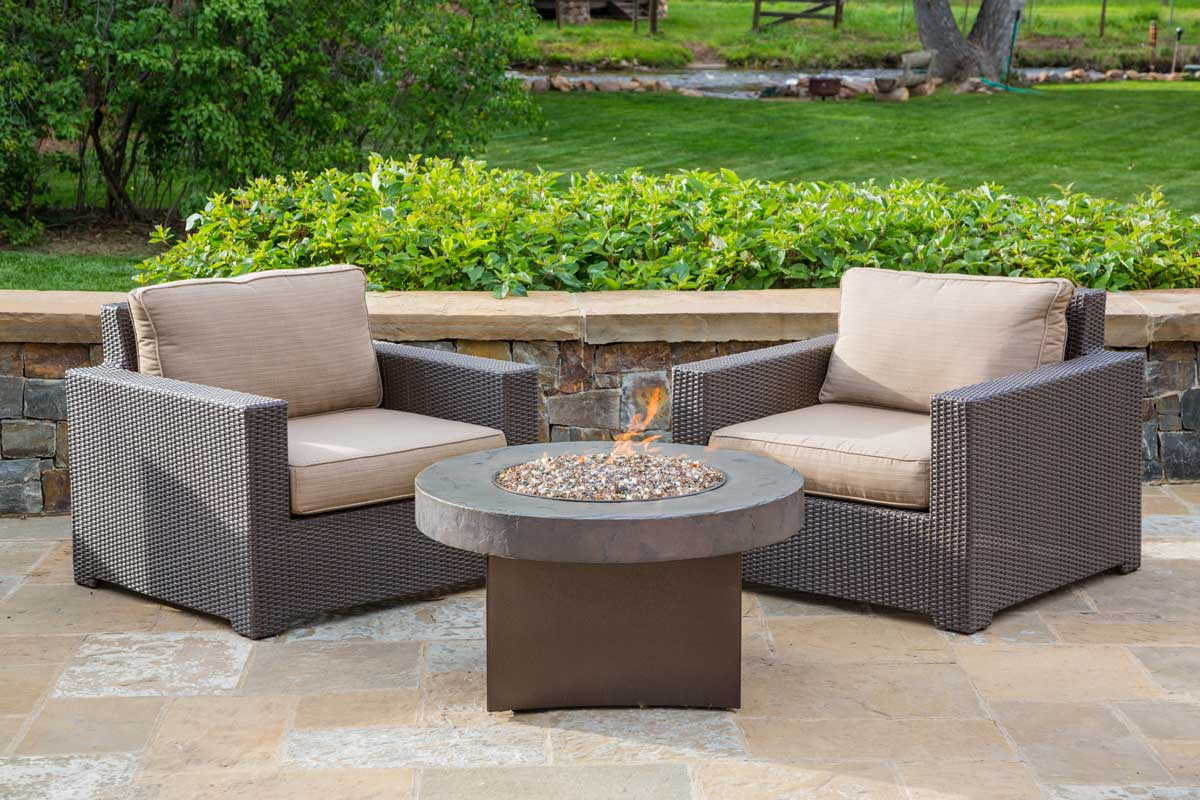 Malibu Collection Wicker Club Chair around an Oriflamme fire table